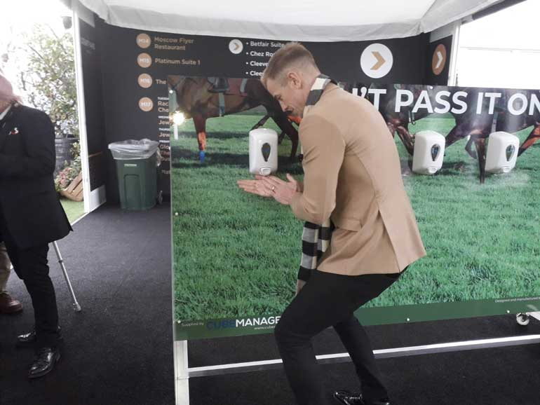 joe hart hand sanitises at cheltenham festival
